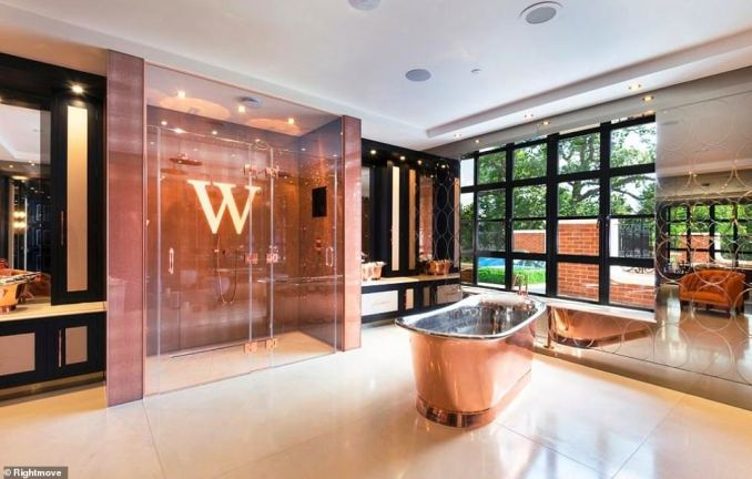The glamour continues throughout the place, with slickly-design master suites and one of the bathrooms features a copper freestanding tub and double shower