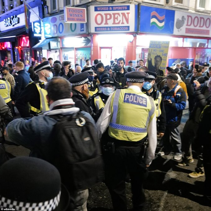 Police officers tried to manage the crowds as revellers left the pubs and restaurants in Soho at 10pm this evening