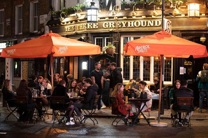 Party-goers opted to spend a night in pubs and bars last night in Soho, London, before the capital is placed under tighter coronavirus lockdown restrictions