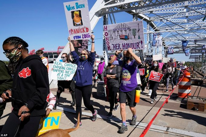 The Nashville march organizers said their goal was to 'send an unmistakable message of our fierce opposition to Trump and his agenda, including his attempt to fill Ruth Bader Ginsburg's seat'