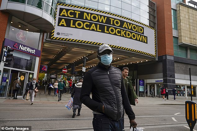 The collateral damage in terms of health and to the economy would be simply devastating. For a start, it is crude and lazy to close pubs in Penzance and restaurants in Richmond because of family transmission in Liverpool and Manchester.A man is seen above wearing a face mask in Manchester