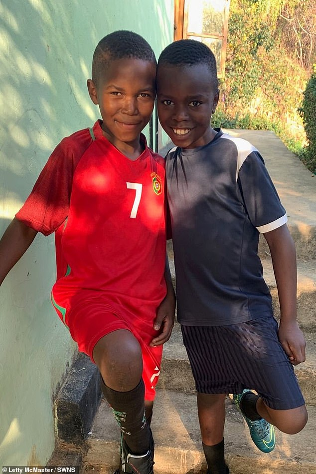 Pictured:Fred and Eliah, the youngest boys in Letty's house.Eliah, was found on the streets in the middle of winter wearing just a T-shirt after his mother passed away. He is now in the top 20 of pupils in his year at his school.Fred, 11, had not eaten for days when he was spotted cowering in a dump. Since moving into the family home in 2019, he's been accepted into a prestigious football academy