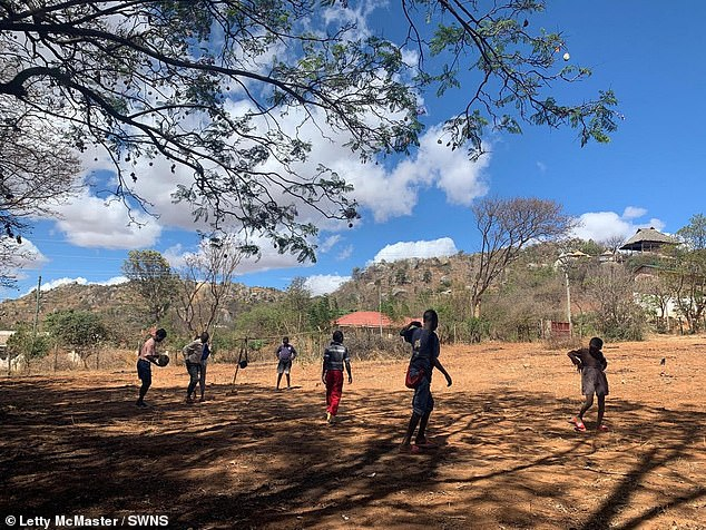 Lettylives in Iringa with the children nine months of the year, coming to the UK for the rest of the year to fundraise through sponsored events and an annual charity ball. Pictured: some of the children playing