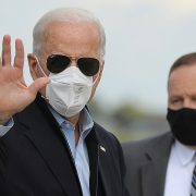Joe Biden keeps his mask on through Michigan event