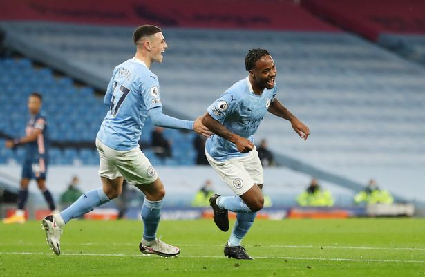 Raheem Sterling celebrates scoring a goal