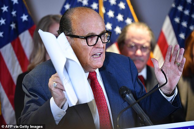 Trump's personal lawyer Rudy Giuliani speaks during a press conference at the Republican National Committee headquarters in Washington, DC, on November 19, 2020. Giuliani is alleging a massive fraud and sketched out a conspiracy involving Democratic cities, Venezuela, China, and Biden