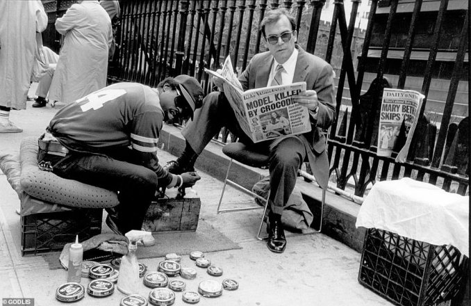 A business man gets his shoes shined while reading the New York Post story about Ginger Meadows, a 24-year-old model who was killed by a giant crocodile in 1987