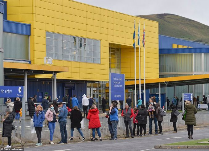 Hundreds of shoppers queue at Ikea's store in Straiton, Edinburgh, after it was confirmed that shoppers from higher-tier areas, including would no longer be able to travel to the store, which is in Midlothian which is dropping to tier 2. (c) Dave Johnston