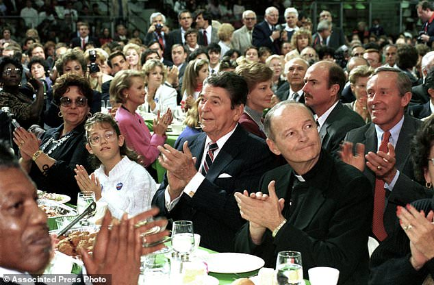 In this Oct. 12, 1988 file photo, President Ronald Reagan, center, and Newark Archbishop Theodore McCarrick, right, attend a Republican party campaign stop in West Orange, N.J