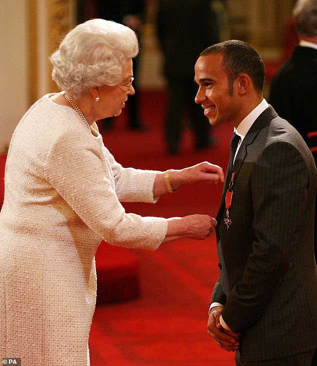 The driver, pictured receiving his MBE from the Queen in 2009,will receive the gong despite his controversial tax affairs