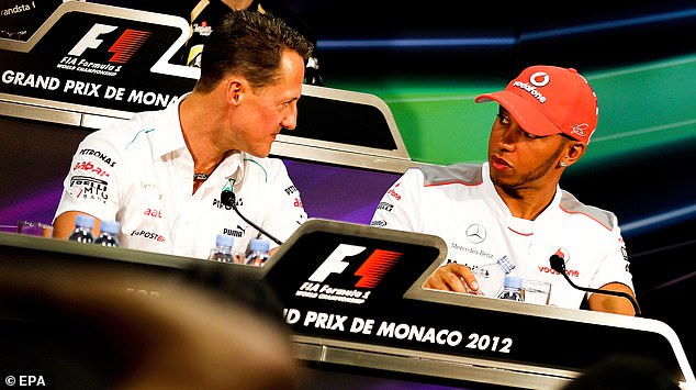 Hamilton is now the most successful driver in Formula One history. He has more race wins than Michael Schumacher (the pair pictured in 2012) and has matched his championship win record