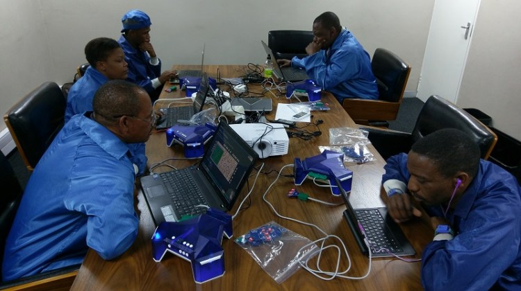 technical workers learning electronics in south africa