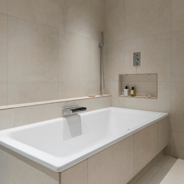 Isle Porcelain Perla tiling around a modern bath