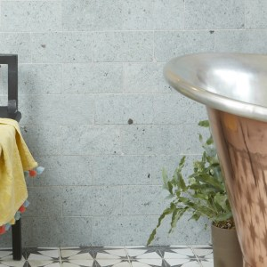 Jakarta Quartzite Brick Sawn Finish Beside a Bronze Bathtub