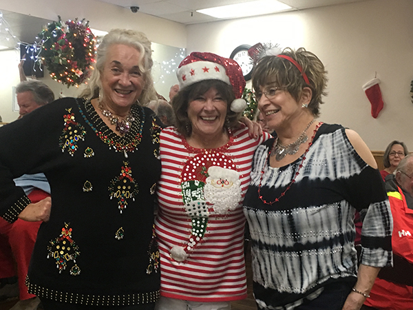 Santa's Elves showing off the Christmas Sweaters!
