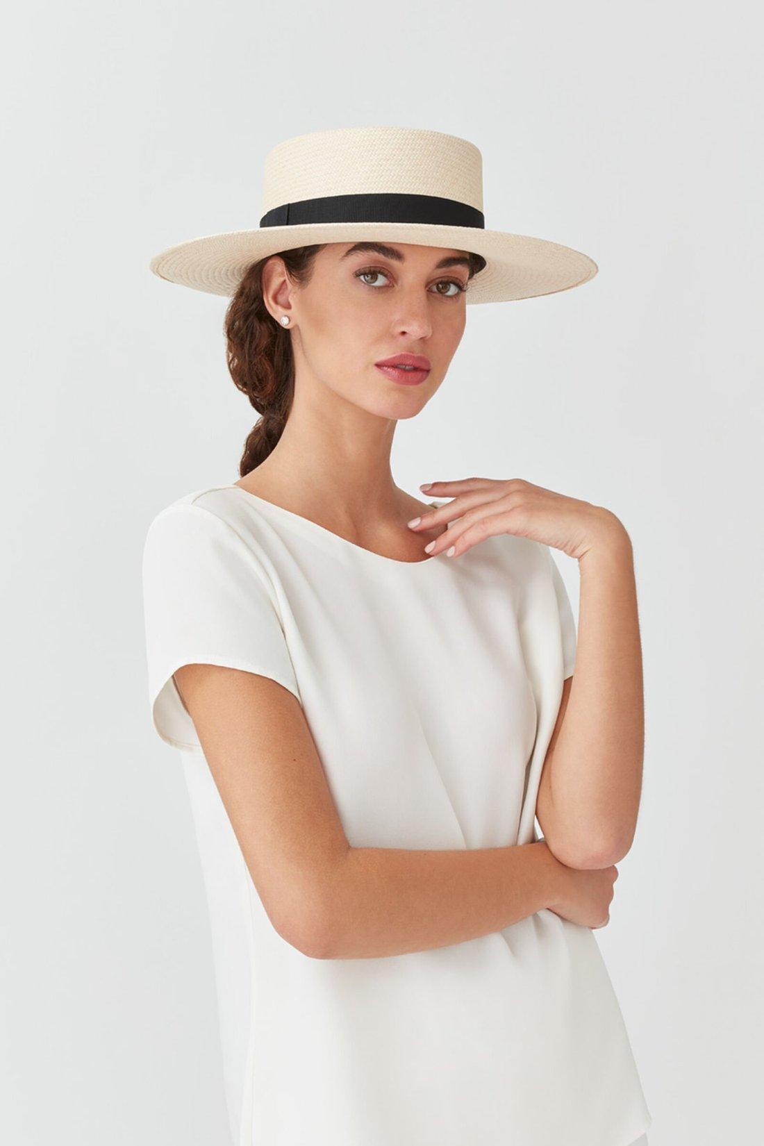 Female model wearing CUYANA Straw Bolero Hat