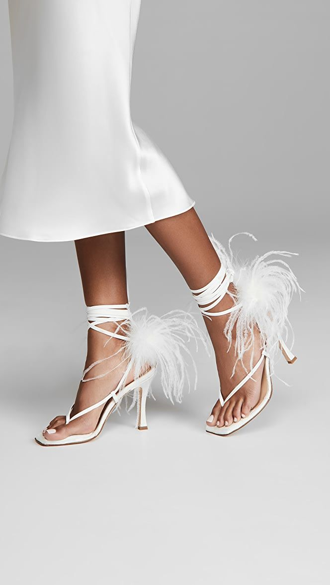 Black female model wearing Brother Vellies paloma feathered wrap sandals