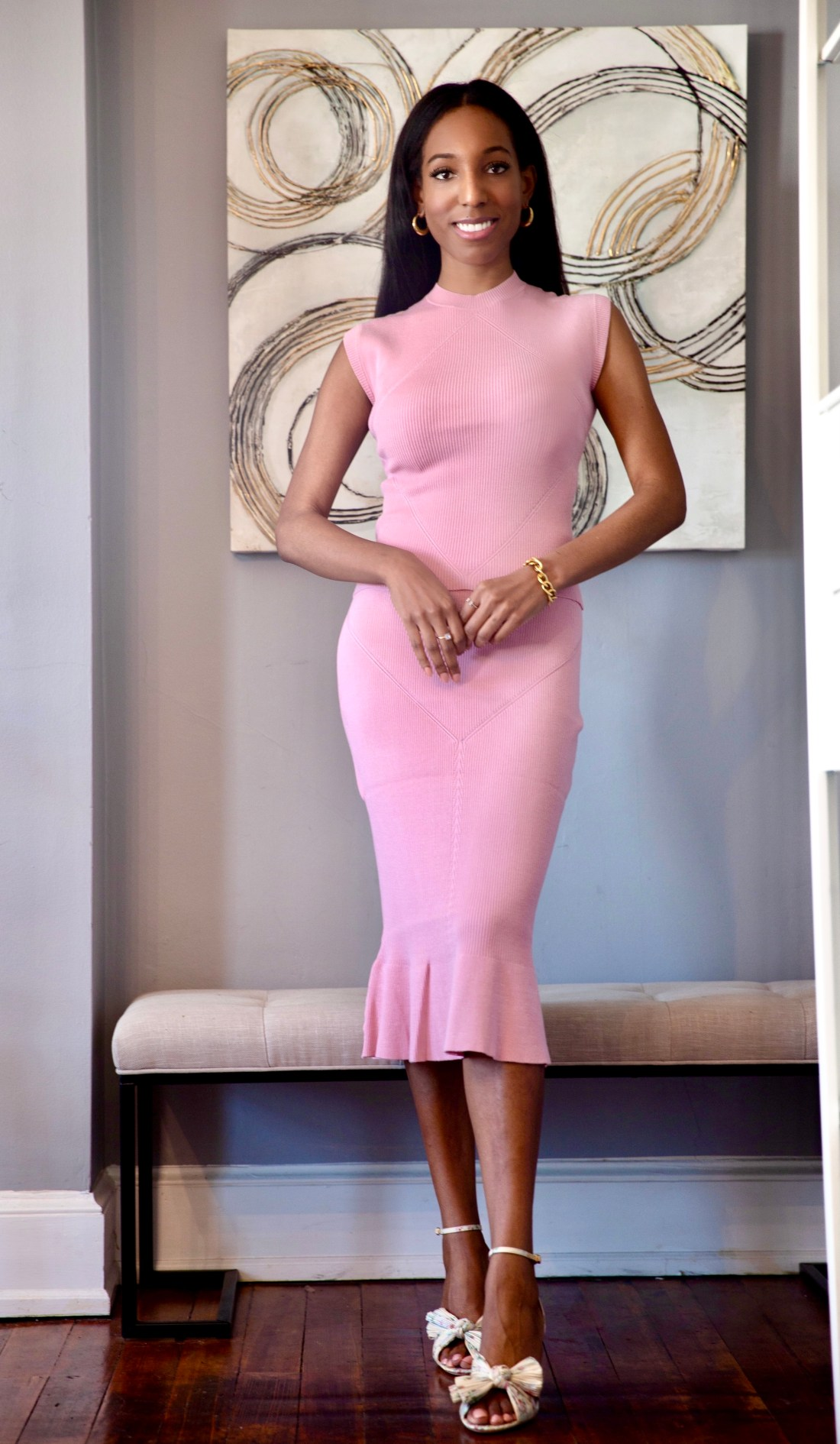 Lana Jackson wearing Undra Celeste New York Rib Cap Sleeve Knit Top in Power Pink and Rib Trumpet Knit Skirt in Power Pink
