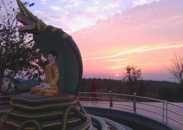 Stunning sunrise just next to the Buddha statue at Shwe Chaung Meditation Center