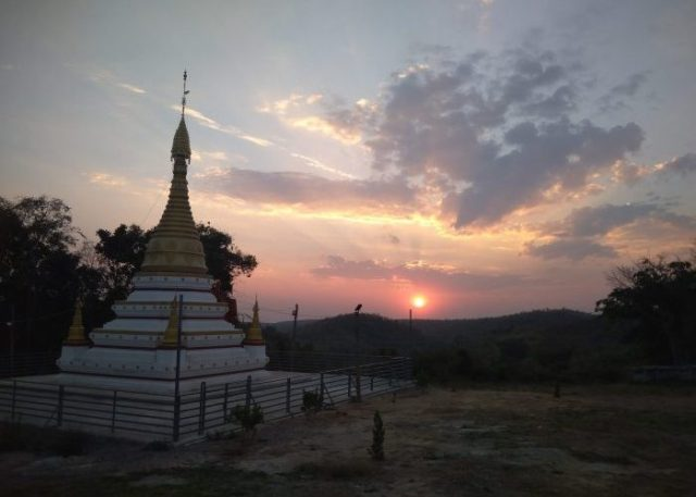 Amazing sunset next to the Buddhist stupa in the mountains in Myanmar
