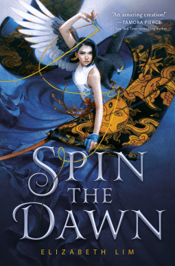 Spin the Dawn by Elizabeth Lim cover shows a girl holding magic scissors and a bolt of fabric with a hawk behind her
