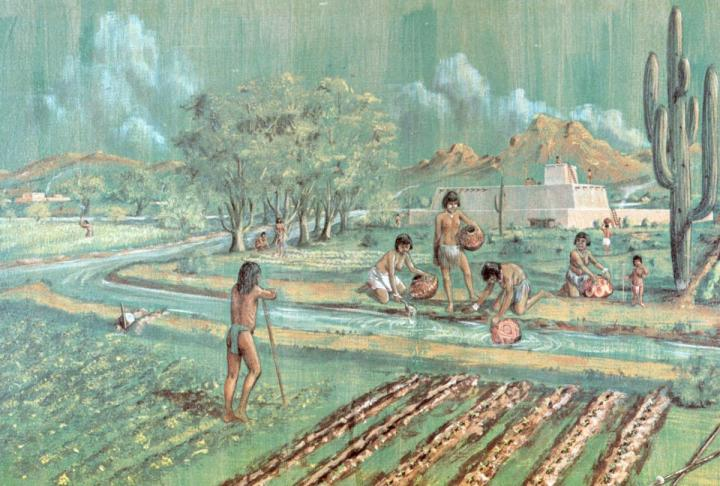 People working the fields of crops in Snaketown, with a pyramid in the distance