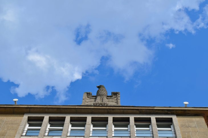 An old Nazi eagle watches over the former State Employment Agency.