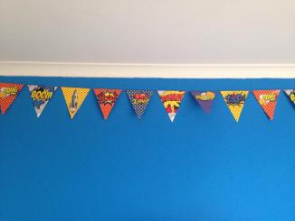 superhero room - bunting and blue walls