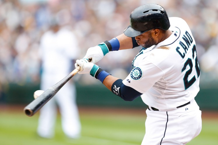 Sep 28, 2014; Seattle, WA, USA; Seattle Mariners second baseman Robinson Cano (22) hits against the Los Angeles Angels during the first inning at Safeco Field. Mandatory Credit: Joe Nicholson-USA TODAY Sports