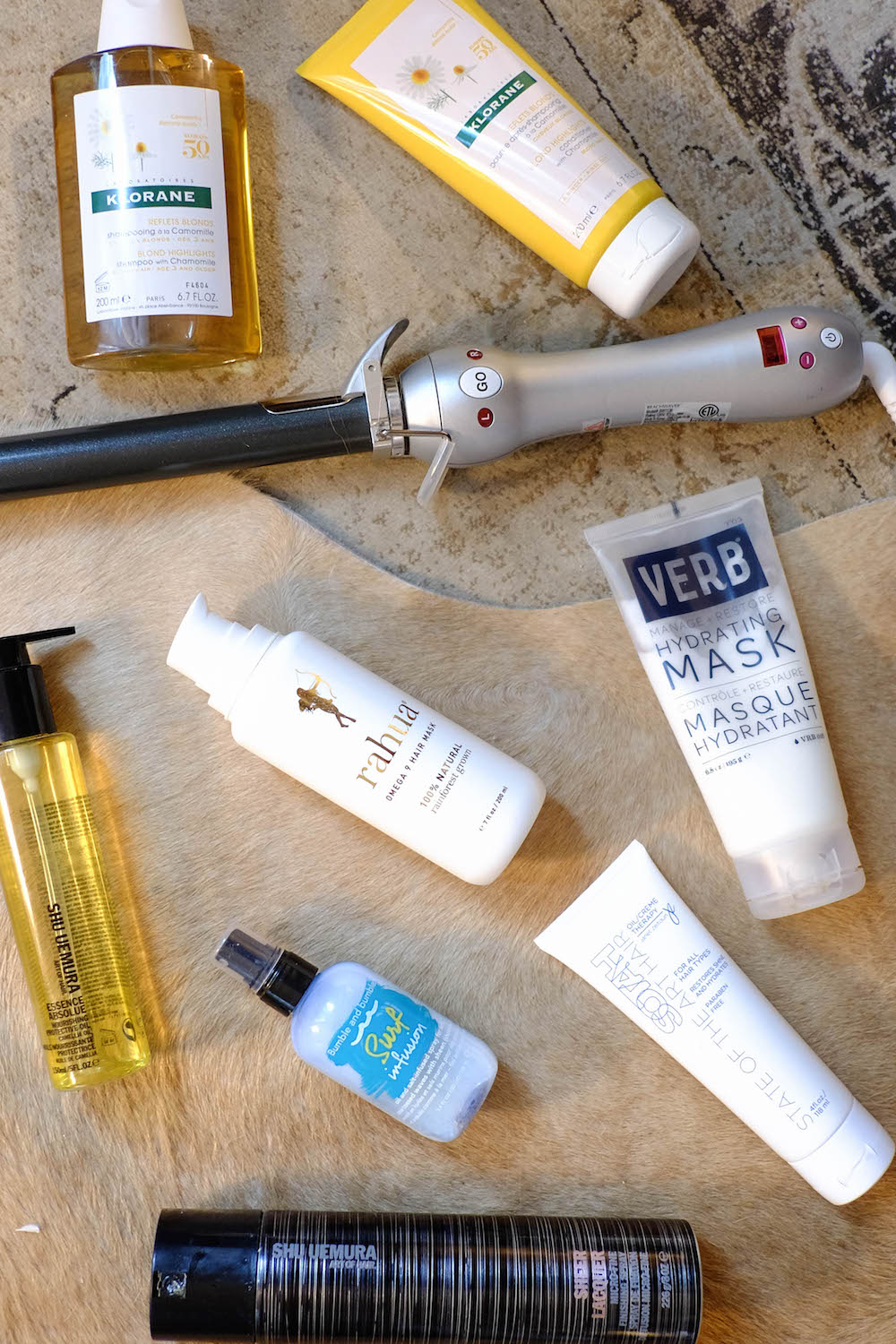 The Best Summer Hair Products - The Stripe Blog. Klorane Blond Highlights Shampoo + Conditioner, Rahua Omega 9 Hair Mask, VERB Hydrating Mask, Bumble + Bumble Surf Infusion, Shu Uemura Sheer Lacquer, Shu Uemura Essence Absolue, Sarah Potempo Beach Waver, Bulbe + Bumble Surf Infusion