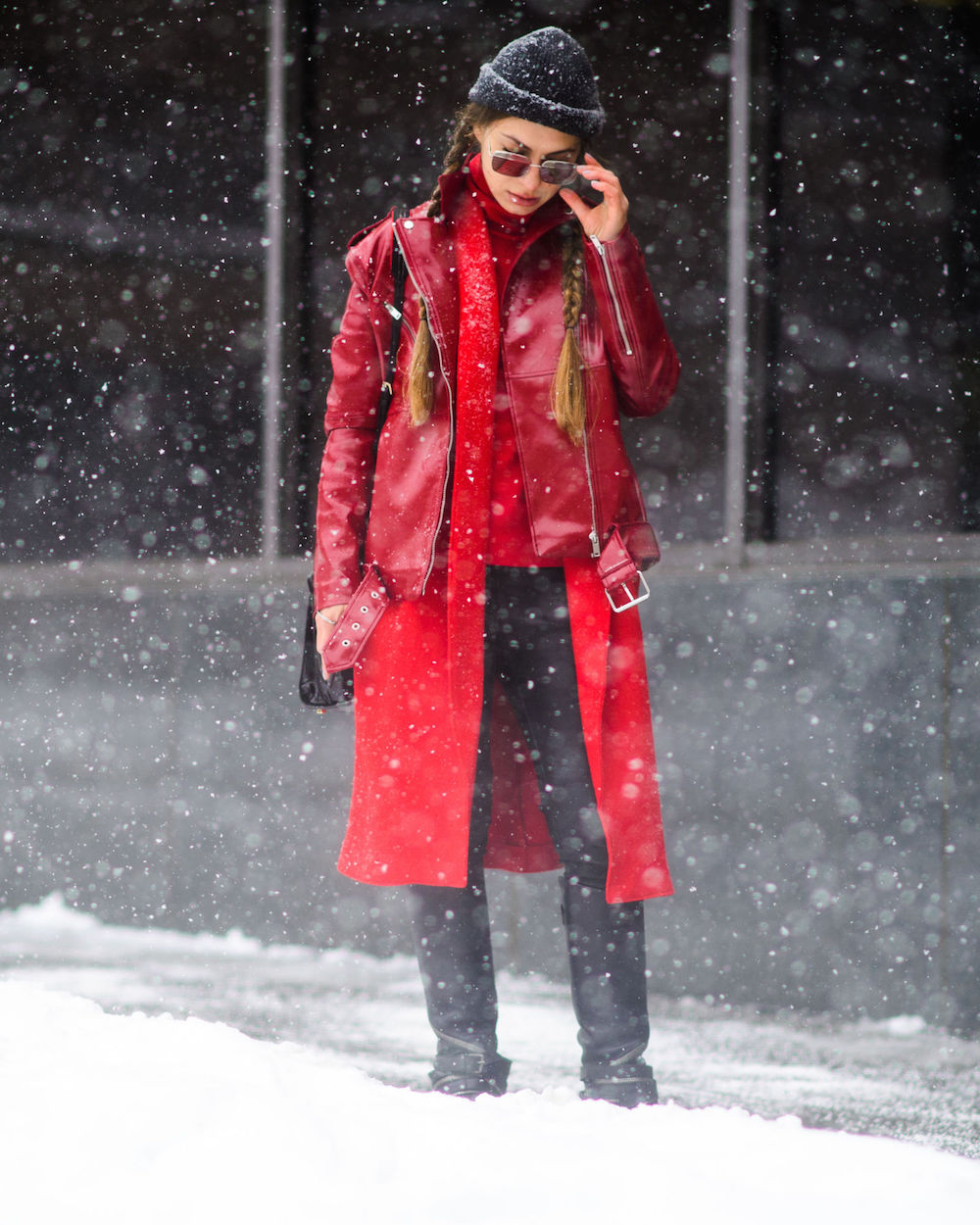 red coat layered under a motorcycle jacket in the same hue | wearable street style nyfw fall 2017 | the stripe blog