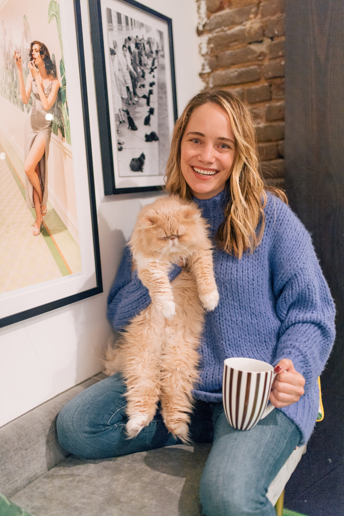 Grace Atwood and her cat in her apartment
