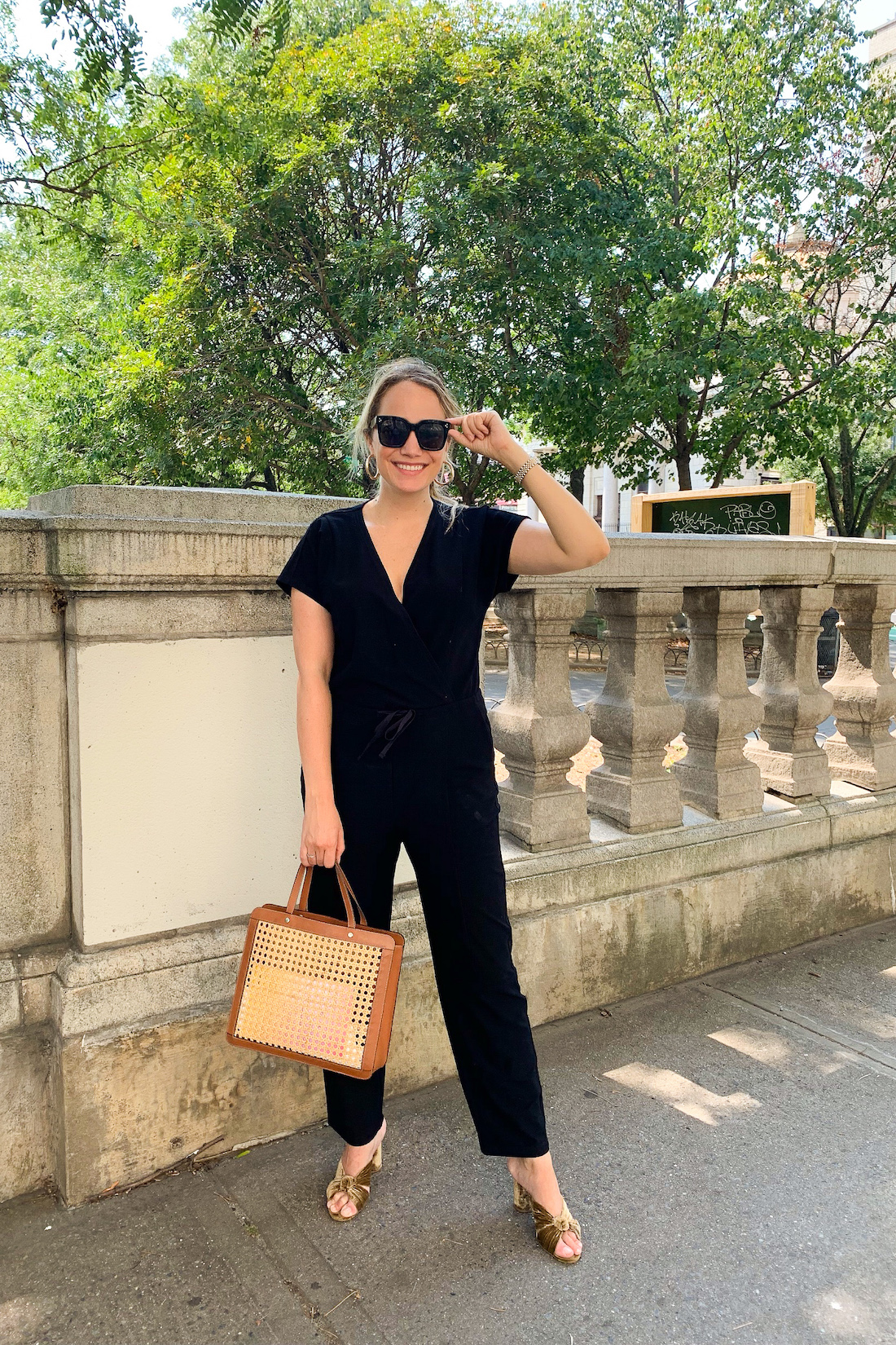 black jumpsuit outfit: grace atwood of the stripe