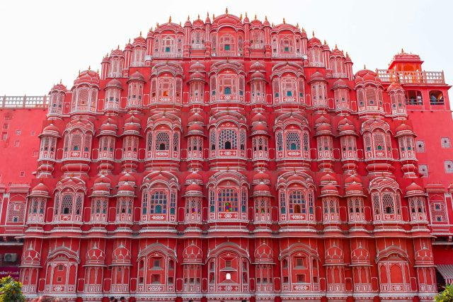 low-angle-photography-of-red-multi-storey-building-3581369
