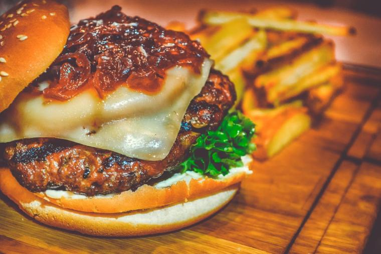 selective-focus-of-ham-burger-on-wooden-surface-photo-750075