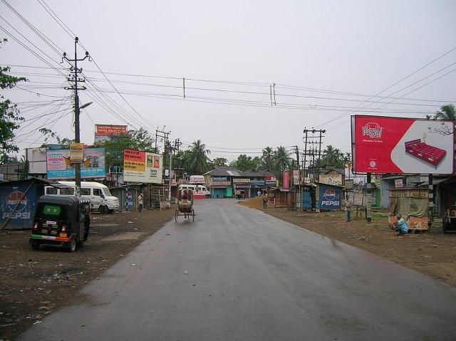 1024px-Karimganj_Silchar_Road,_near_Karimganj_Bus_Station
