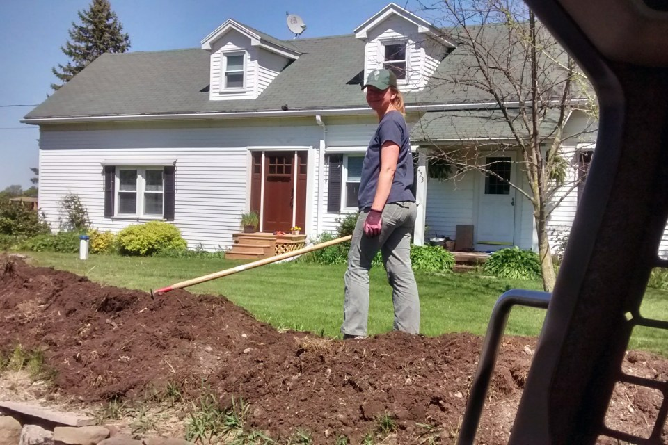 Becky working in the front yard