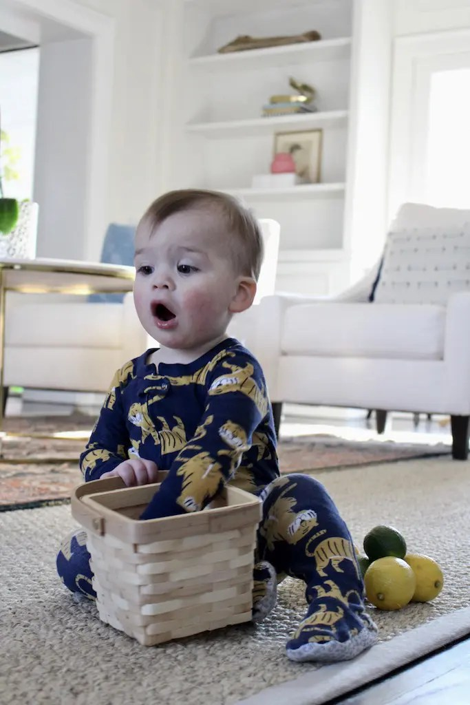 Baby playing with basket of lemons_Emily Schiller RDN