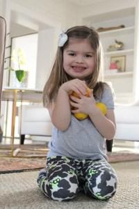 Girl holding lemons_Emily Schiller RDN