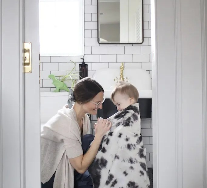 Mom and child in black and white bathroom