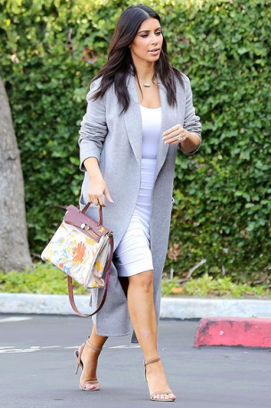 An oversized coat adds sophistication to Kim's outfit