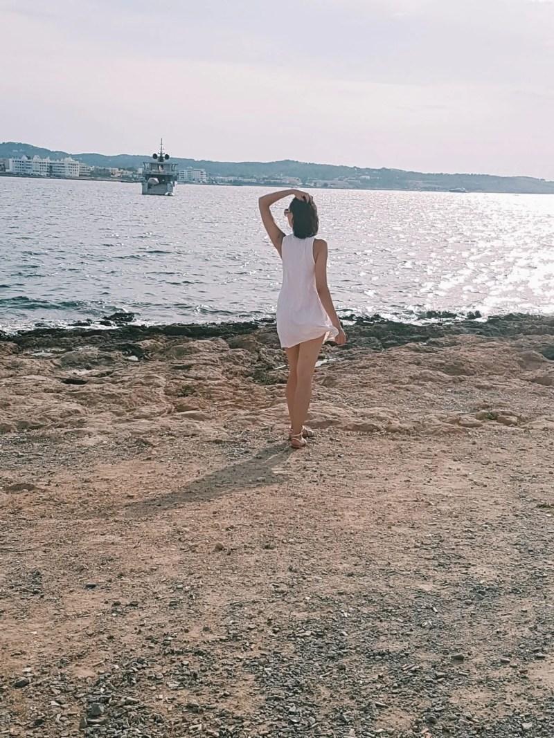 Girl walking on beach in Ibiza