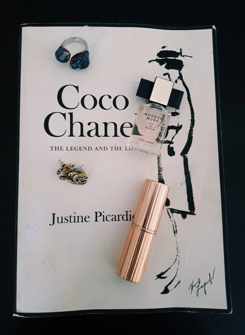 Coco chanel book with lipstick and perfume