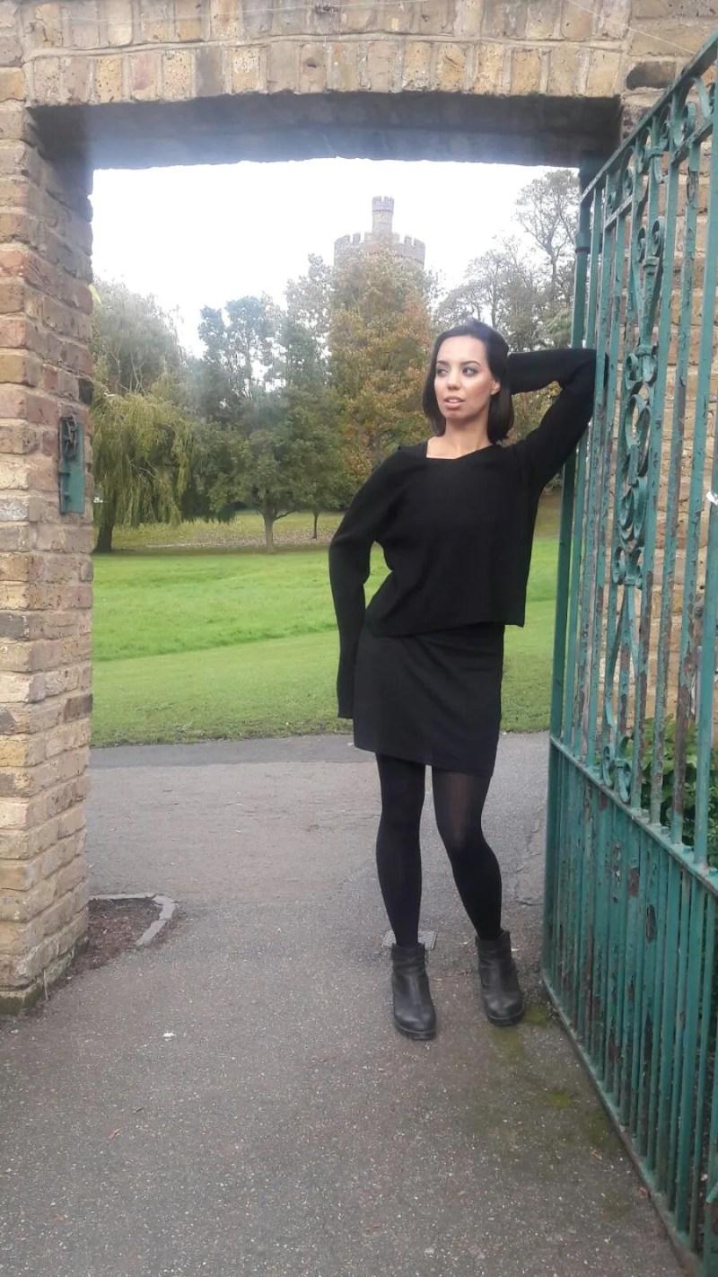 Girl outside all black phone detox