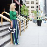 Stefanie from The Style Safari wears a green long sleeve sweater, vertical stripe wide leg pants, black and white graphic clutch // thestylesafari.com