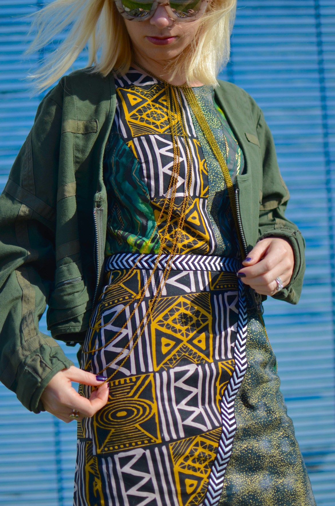 mixed print african dress, army green parachute jacket, gold body chain // thestylesafari.com