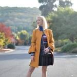 mustard yellow coat, kenzo striped turtleneck, black faux leather skirt, valentino rockstud flats // thestylesafari.com