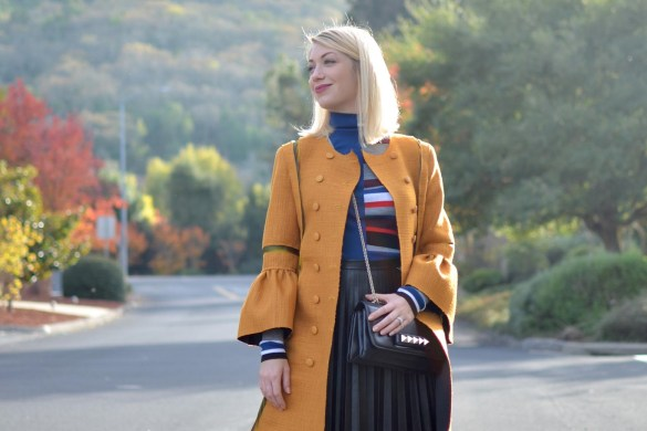 mustard yellow coat, kenzo striped turtleneck, black faux leather skirt, valentino rockstud flats // thestylesafari.com