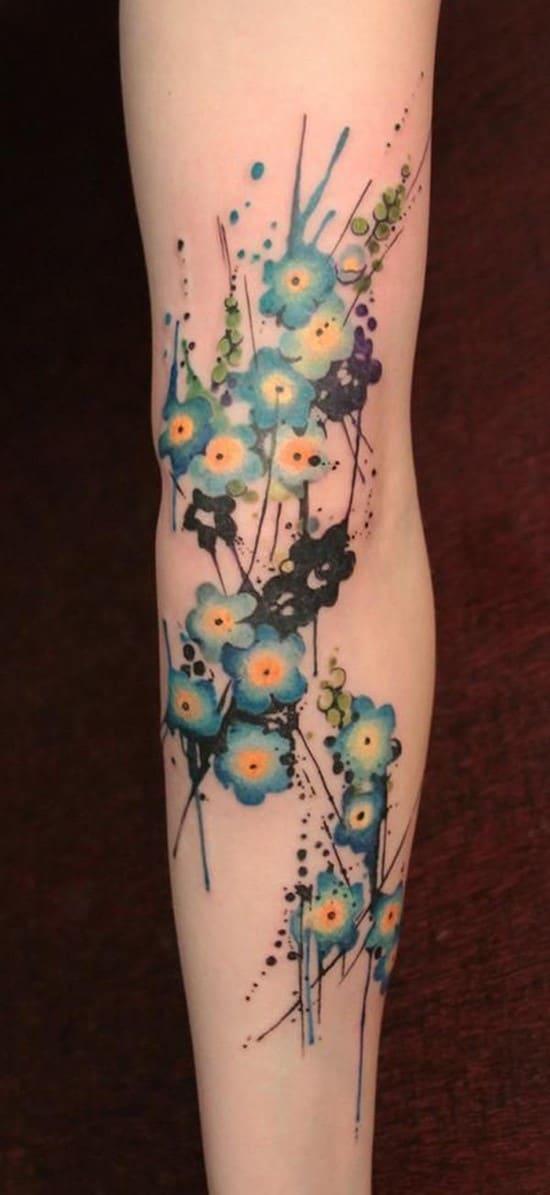 16-Tiny-Blue-Flowers-arm-tattoo