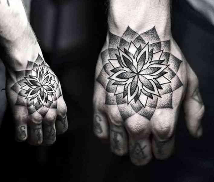 pointillism hand tattoo